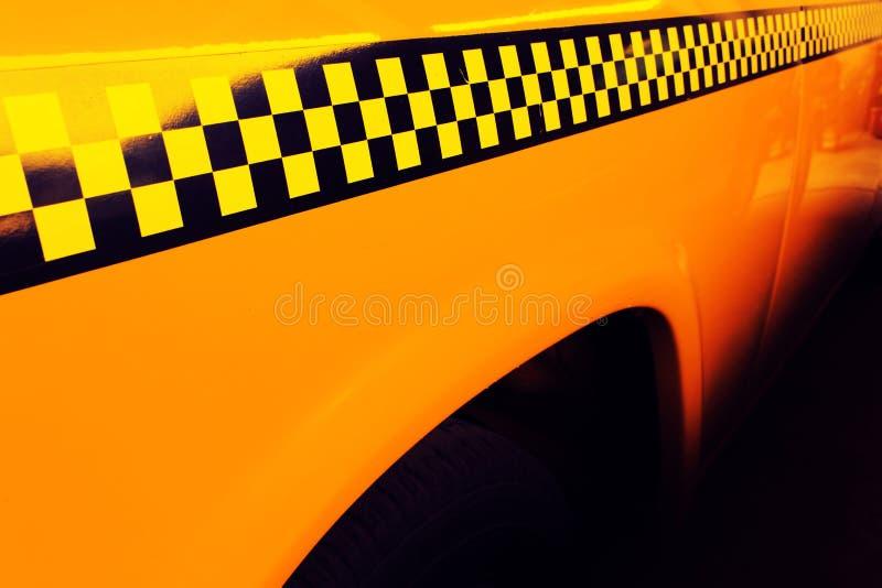 Gelbes Fahrerhaus-Taxi, Detail auf der Seite des Taxi-Kontrolleurs lizenzfreies stockfoto