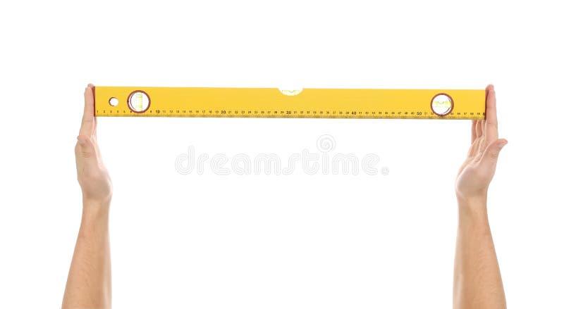 Gelbes Gebäudeniveau in den Händen. lizenzfreie stockfotos