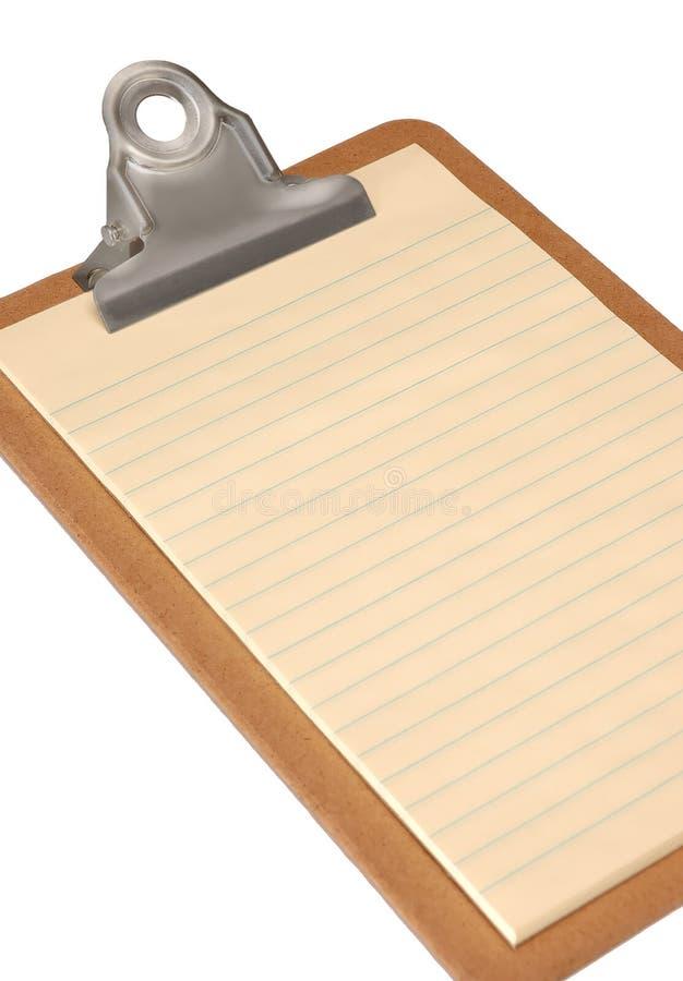 Gelbes Papier auf Klemmbrett stockfotografie