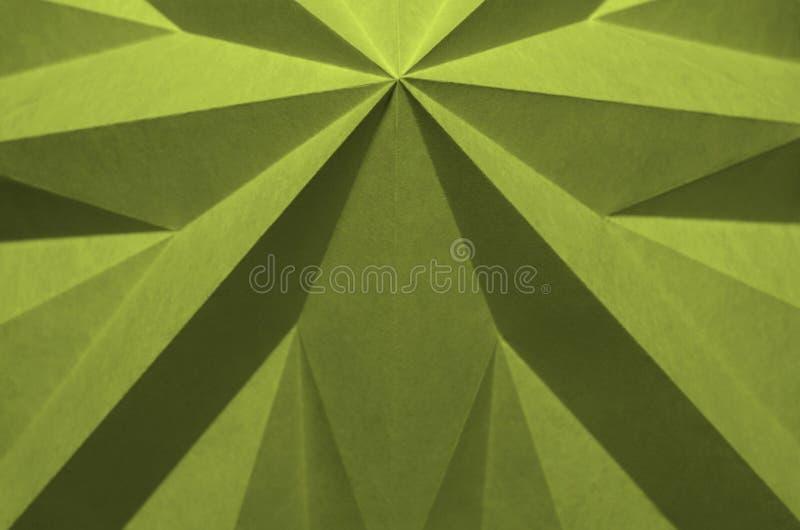 Gelbgrüner einfarbiger abstrakter Hintergrund vom Origami stockfotografie