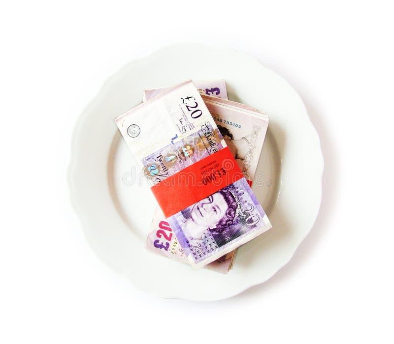 Geld auf einer Platte stockfotos