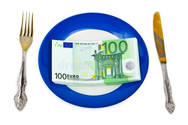 Geld auf Platte lizenzfreies stockbild