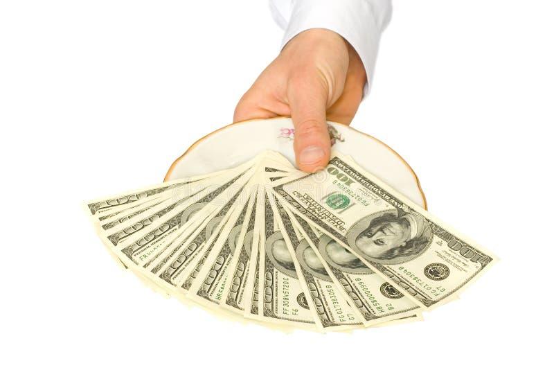 Geld auf Platte lizenzfreie stockfotografie