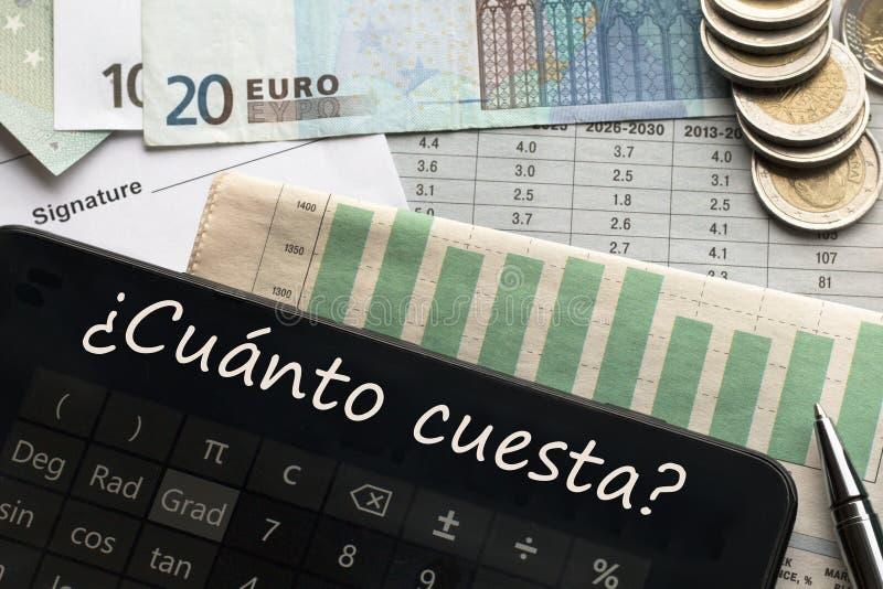 Geld, calculator met hoeveel? tekst in het Spaans royalty-vrije stock afbeelding