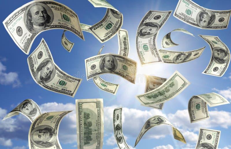 Geld, das vom Himmel fällt stockfoto