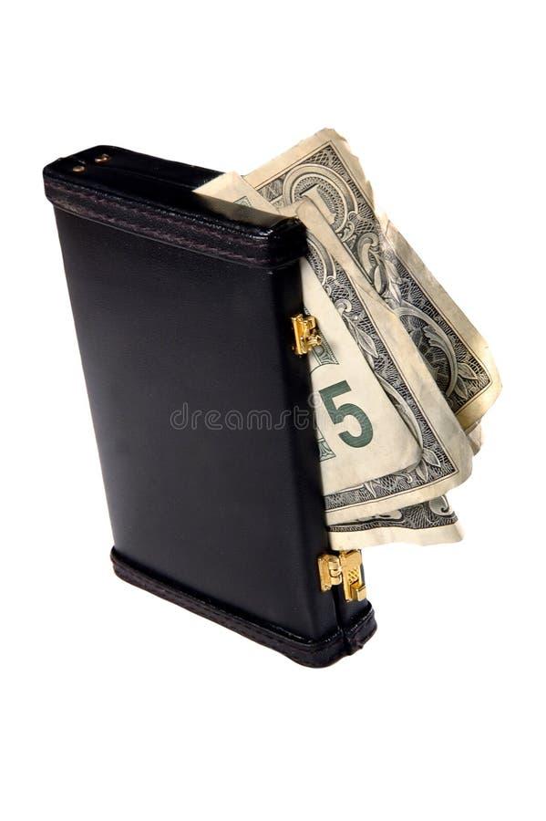Geld dat in aktentas wordt gevuld royalty-vrije stock foto