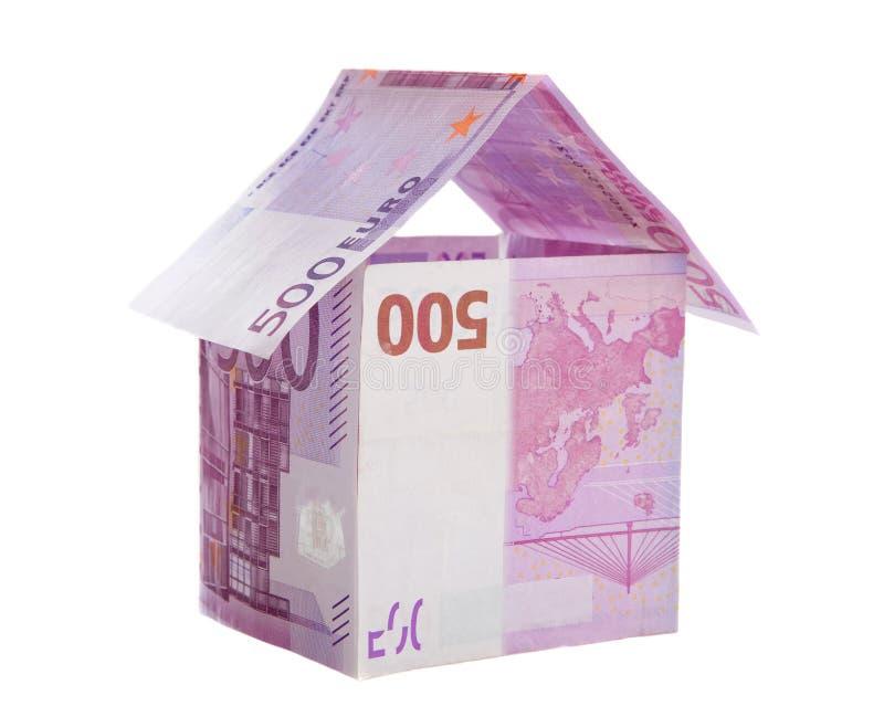 Geld dat een huis symboliseert royalty-vrije stock afbeeldingen