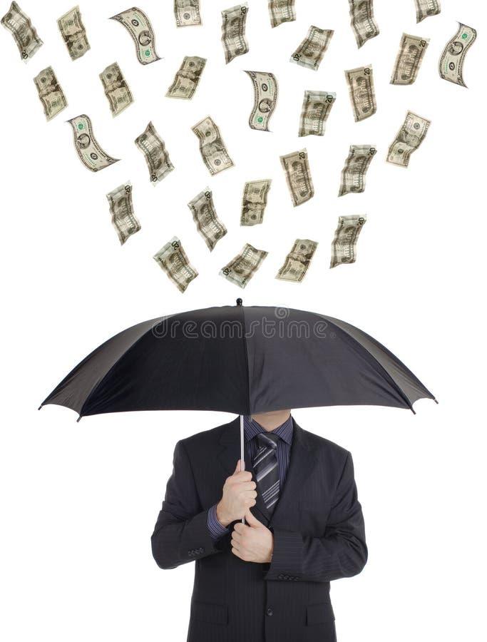 Geld dat neer op een persoon regent stock fotografie