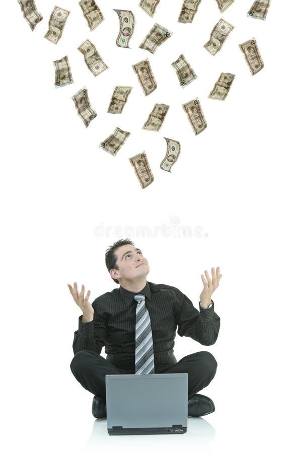 Geld dat neer op een zakenman regent royalty-vrije stock afbeeldingen