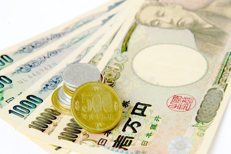 Geld in de Yen stock afbeeldingen