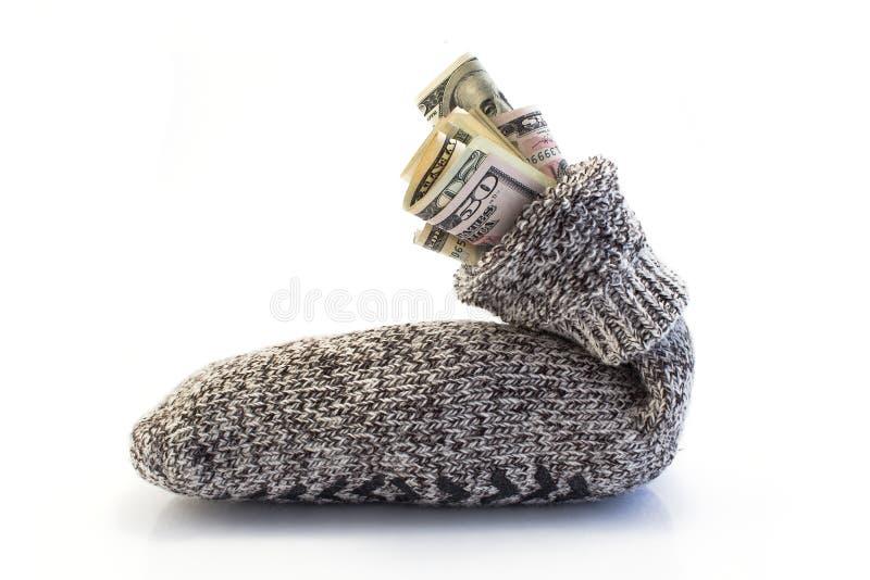 Geld in een sok royalty-vrije stock afbeeldingen
