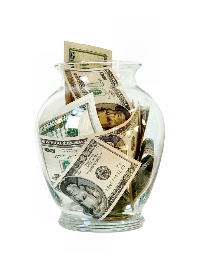 Geld in einem Glasglas lizenzfreie stockfotografie