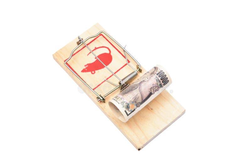 Geld in einem Mousetrap stockbild