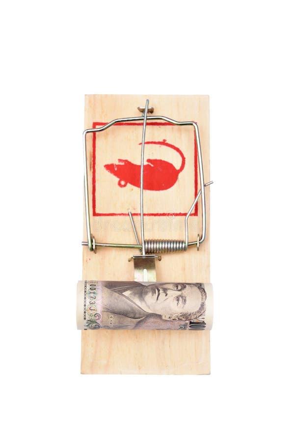 Geld in einem Mousetrap stockfotografie
