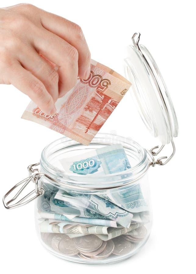 Geld in einem Potenziometer. stockbild