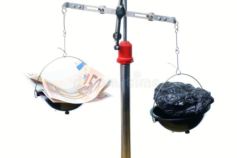 Geld en steenkool stock foto's