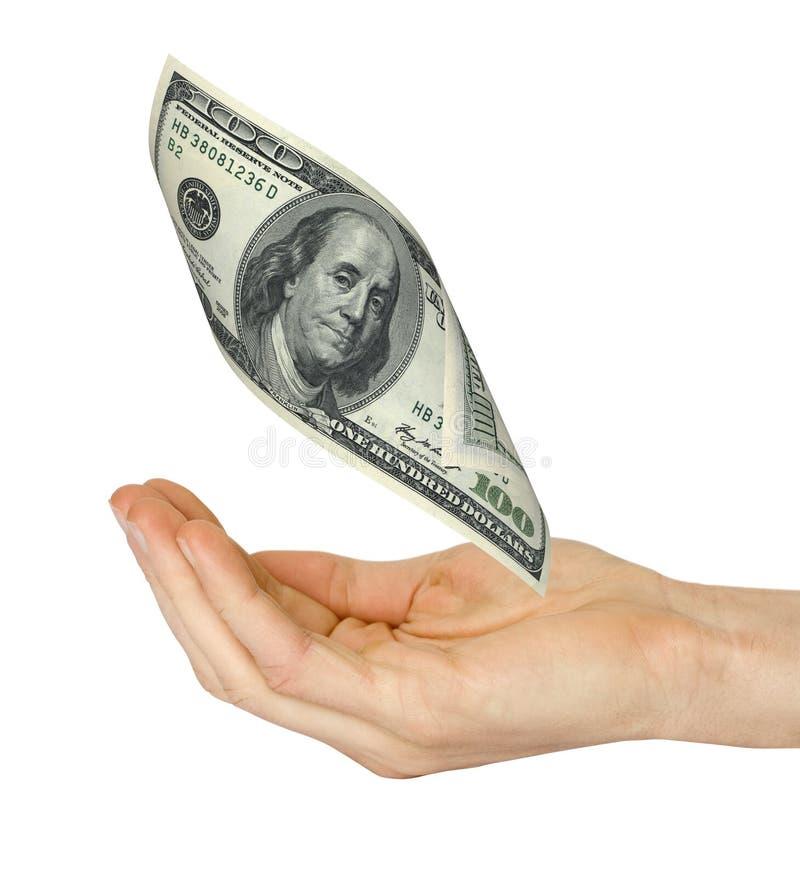 Geld fällt auf eine Hand lizenzfreie stockfotos