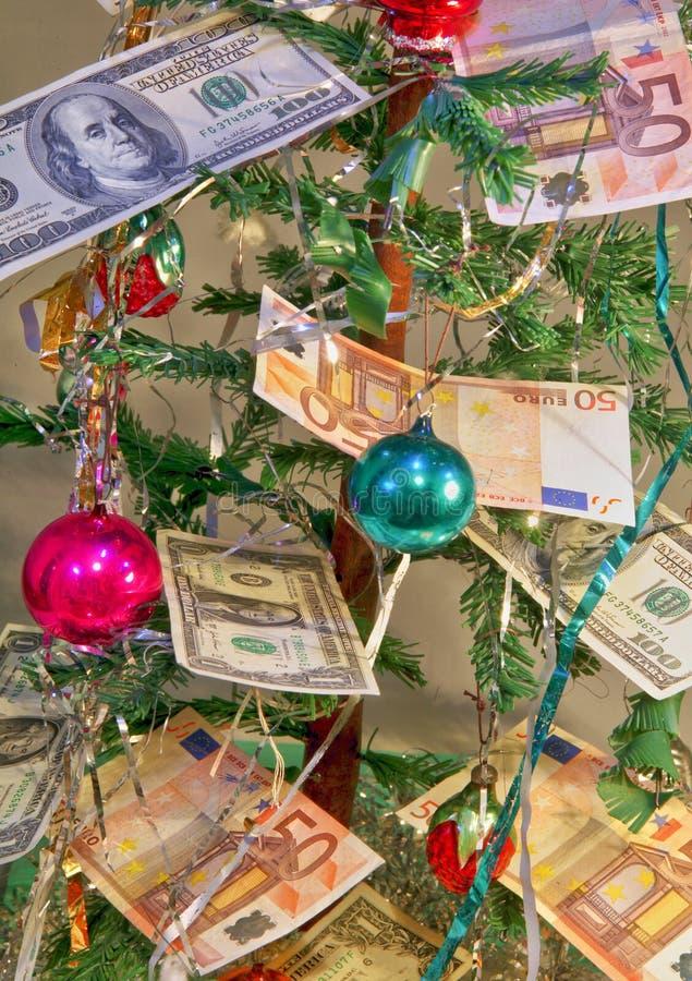 Geld für Weihnachtsgeschenke stockfotos