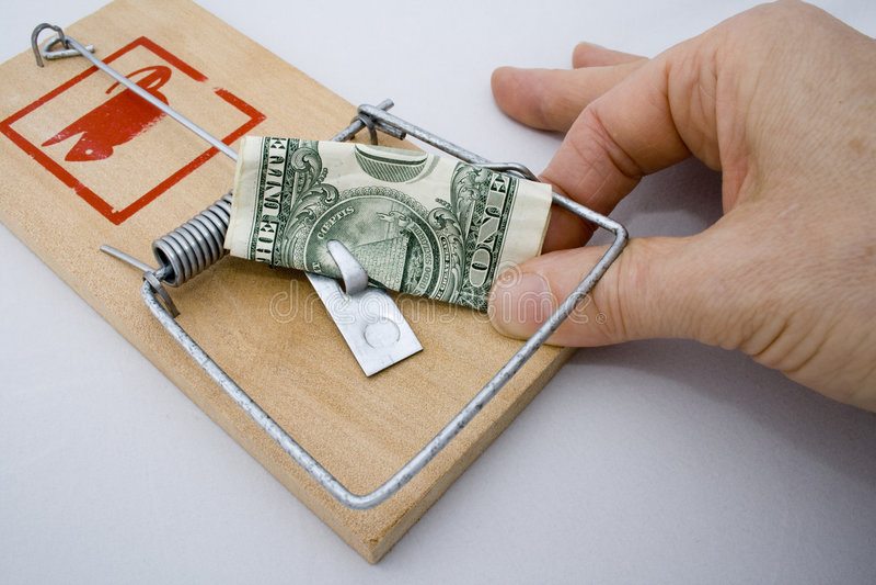 Geld-Falle - US-Dollar u. Hand lizenzfreie stockbilder