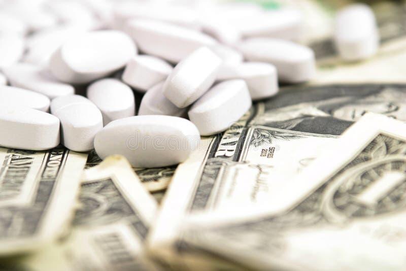 Geld, Geld, Geld auf dem medizinischen Gebiet stockbild