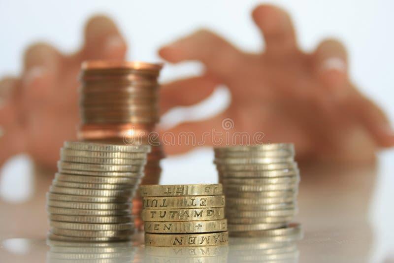 Geld-Grabscher stockfotografie