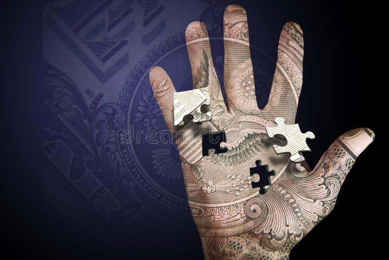 Geld-Handpuzzlespiel stockfoto