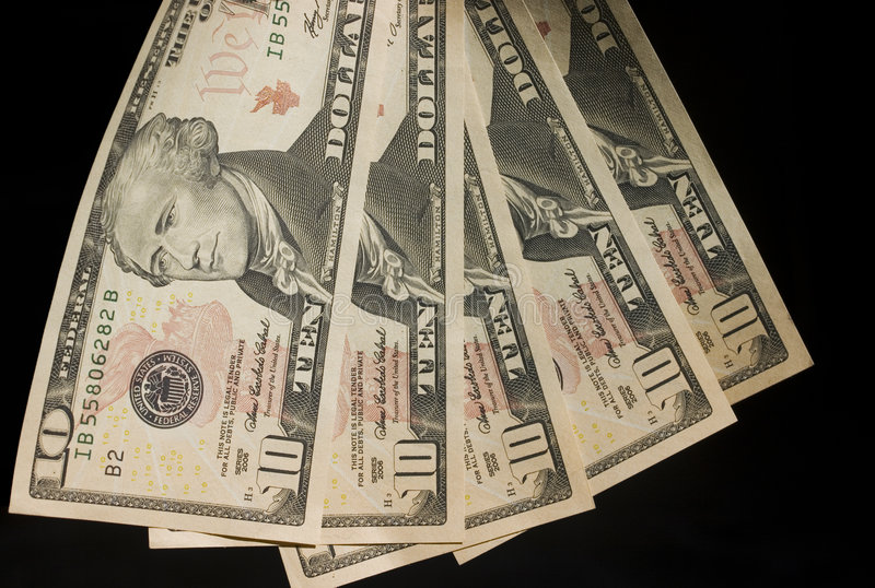 Geld heraus ausgebreitet stockfotos