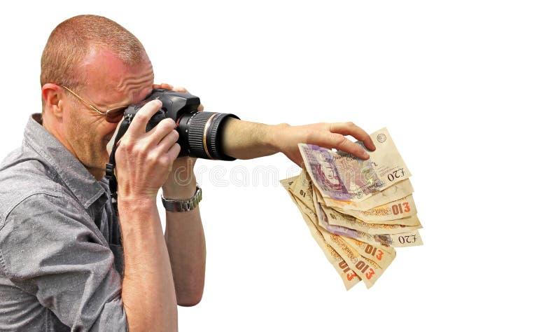 Geld het grijpen camerahand royalty-vrije stock foto's