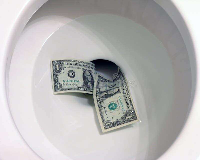 Geld Hinunter Die Toilette Stockbild