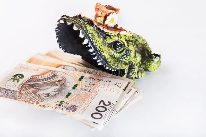 Geld im Mund des Krokodils, polnischer Zloty, PLN lizenzfreies stockbild