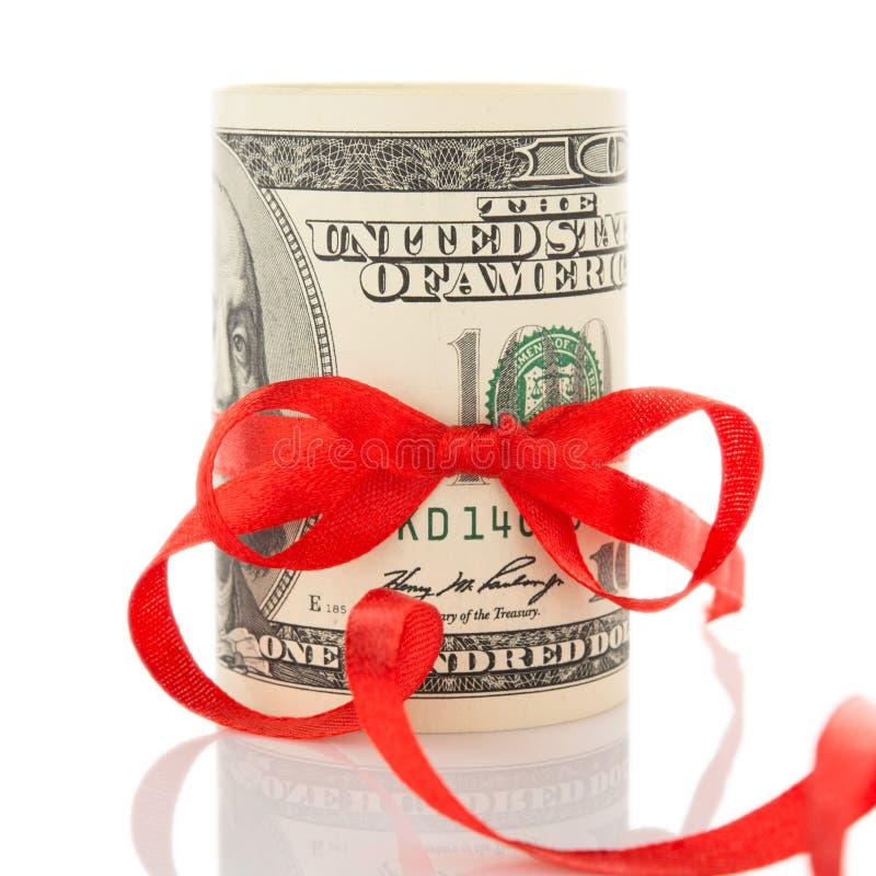 Geld met lint en rode boog stock afbeelding