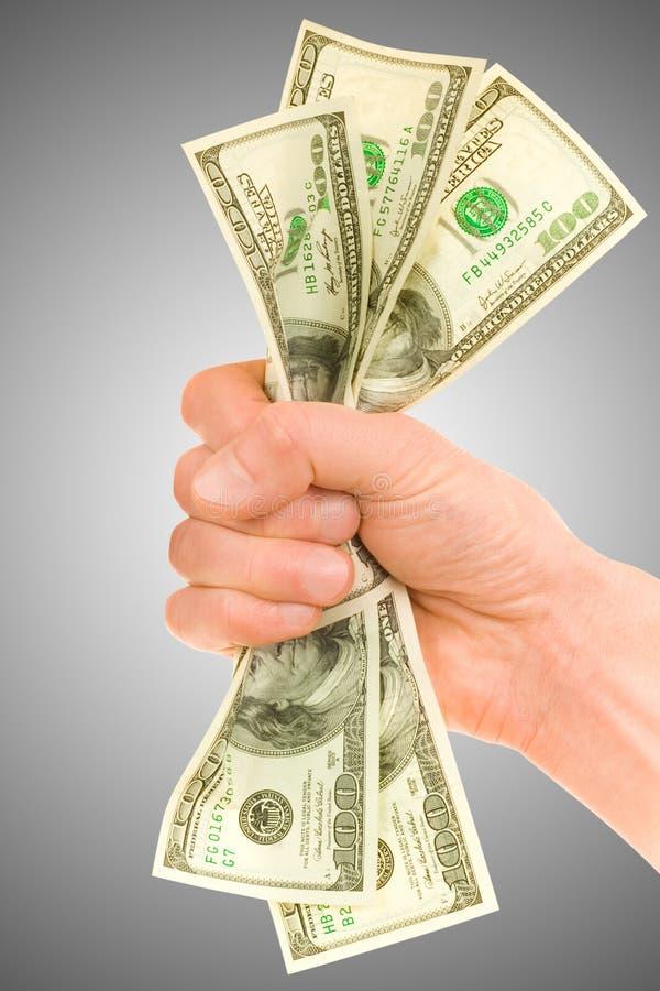 Geld mit der Hand lizenzfreie stockbilder