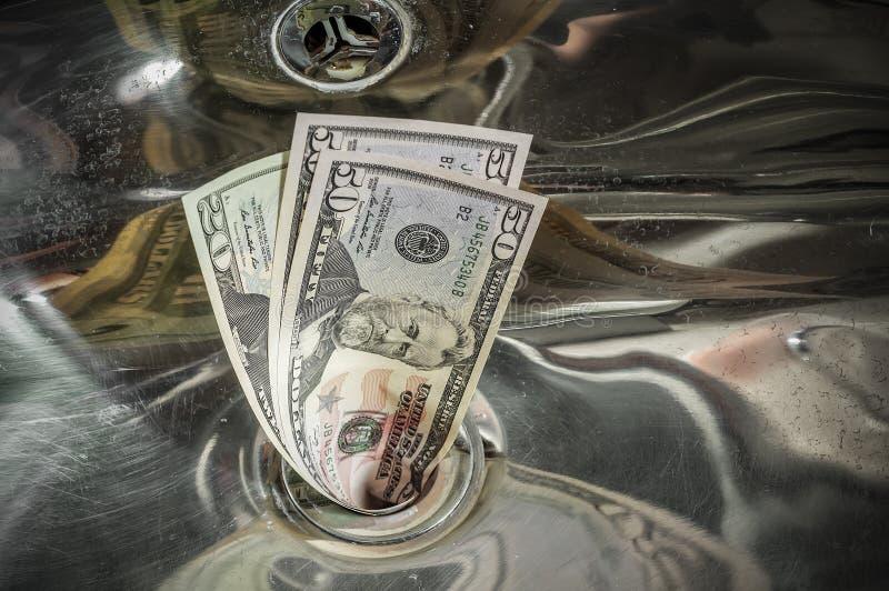 Geld onderaan het Afvoerkanaal royalty-vrije stock fotografie