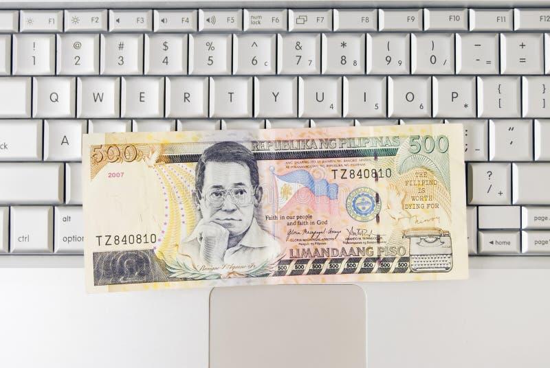 Geld op het Toetsenbord van de Computer stock foto's