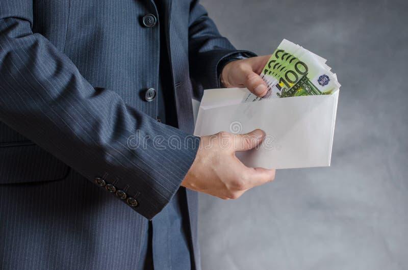 Geld in pakket royalty-vrije stock fotografie