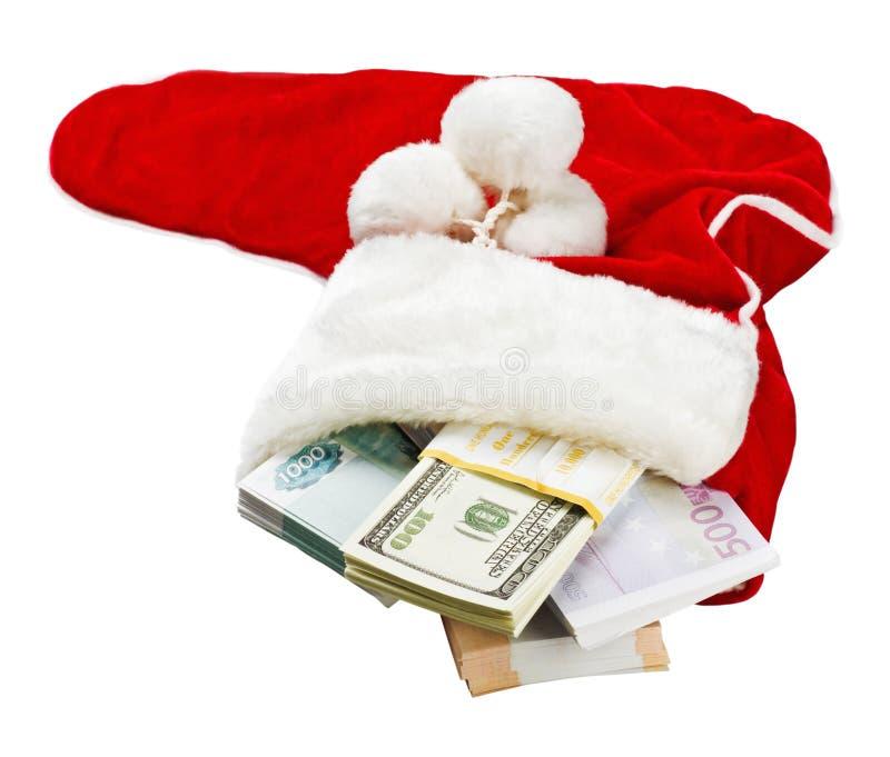 Geld rond de wereld in een sok van Kerstmis stock afbeelding