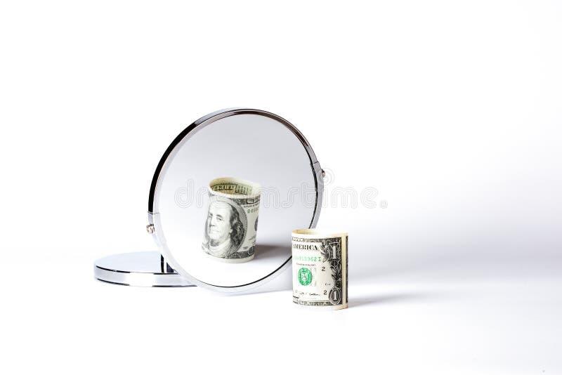 Geld in spiegel stock afbeelding