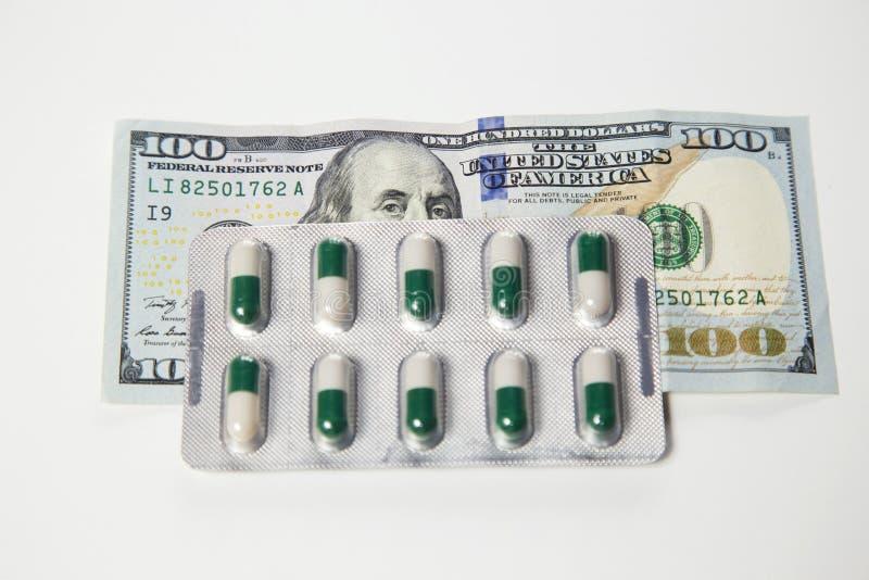 Geld und Gesundheit lizenzfreie stockfotos