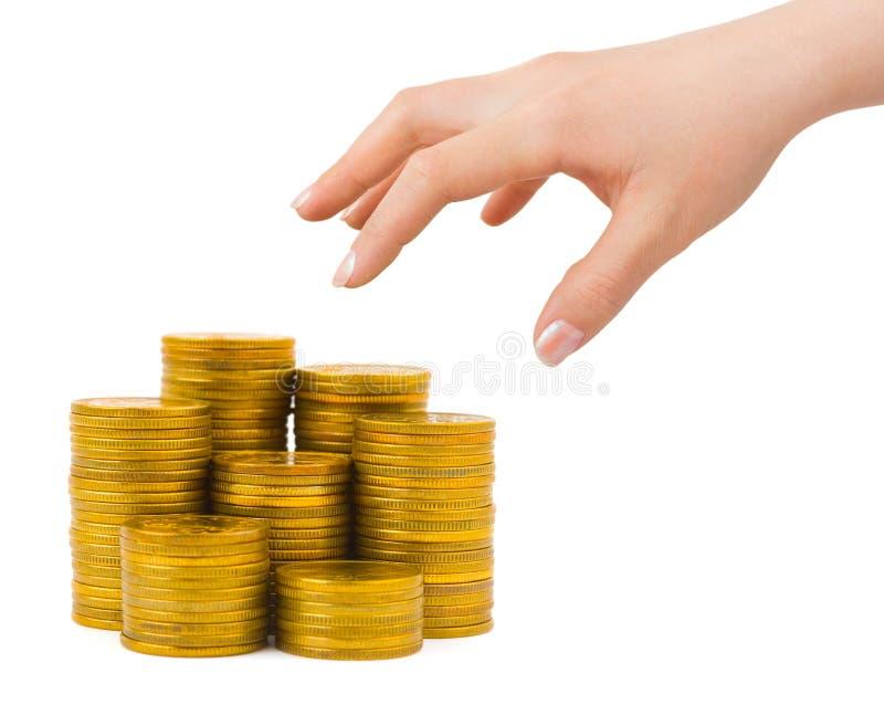 Geld und Hand lizenzfreie stockbilder