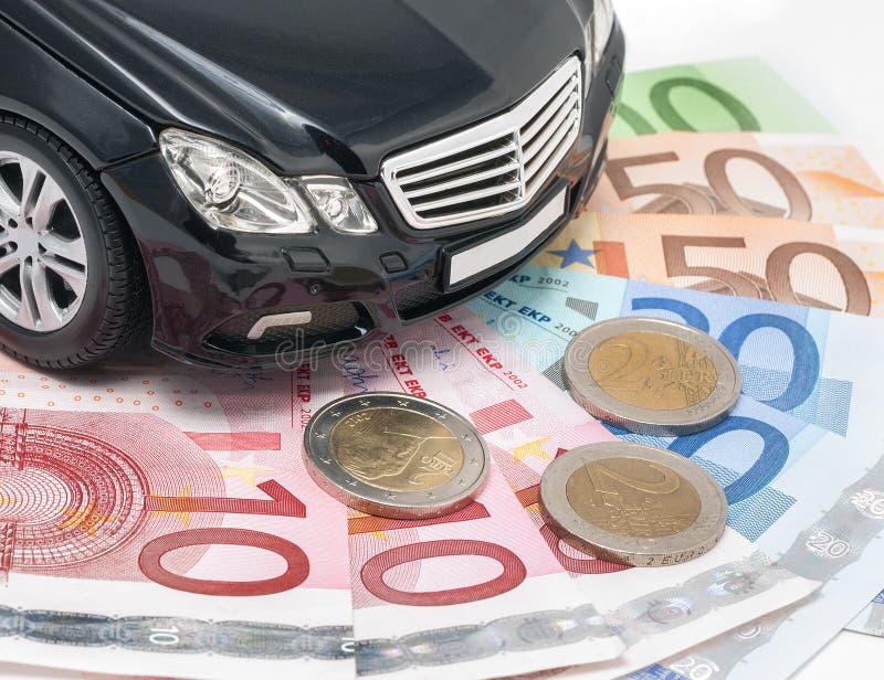 Geld und Neuwagen stockbild