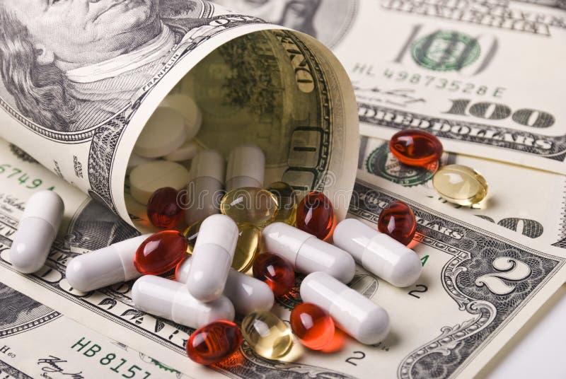 Geld und Pillen stockbilder