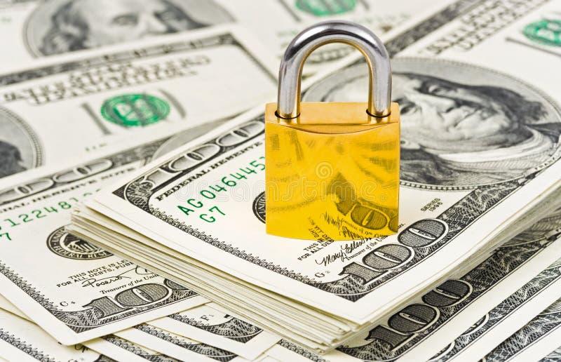 Geld und Verriegelung stockfoto
