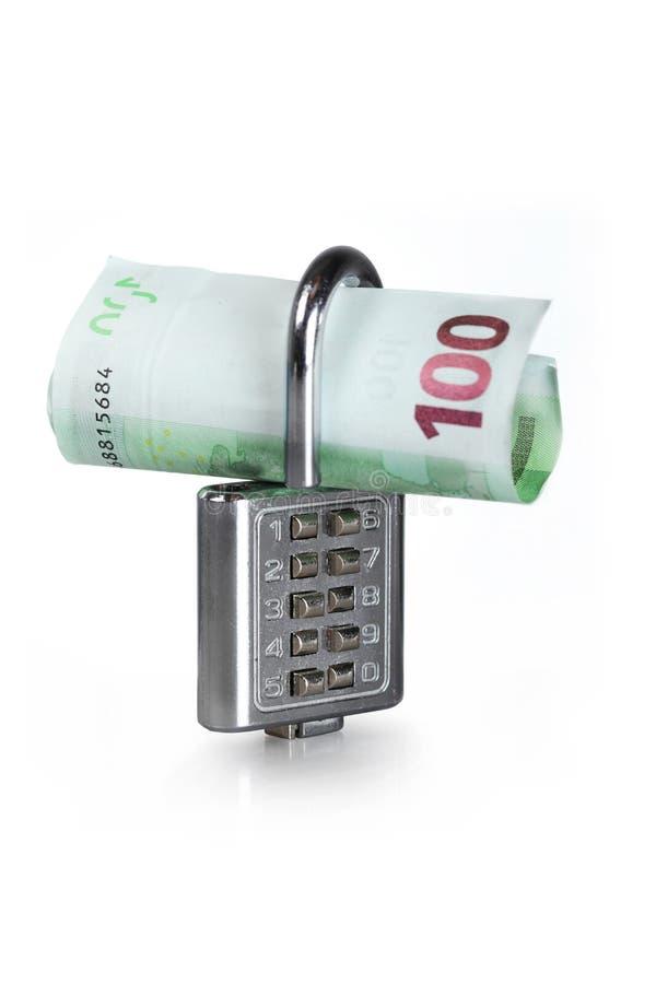 Geld und Verriegelung lizenzfreie stockbilder