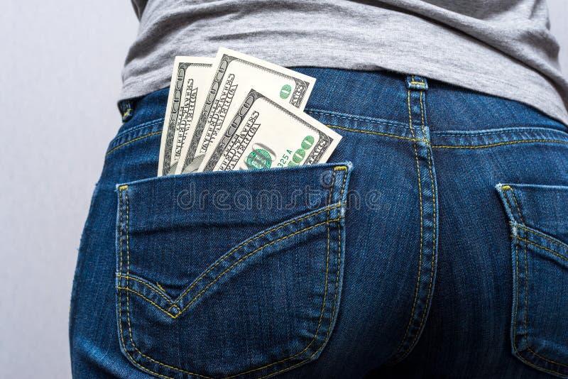 Geld in uw zak stock afbeelding