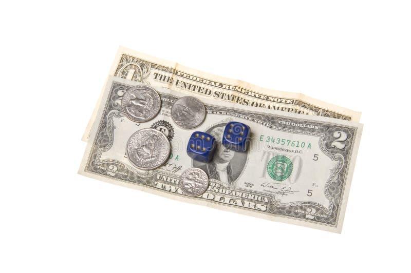 Geld-Würfel und Münzen stockbild