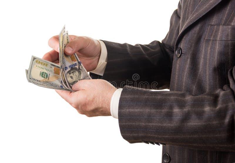 Geld in zakenmanhanden op wit worden geïsoleerd dat royalty-vrije stock foto's