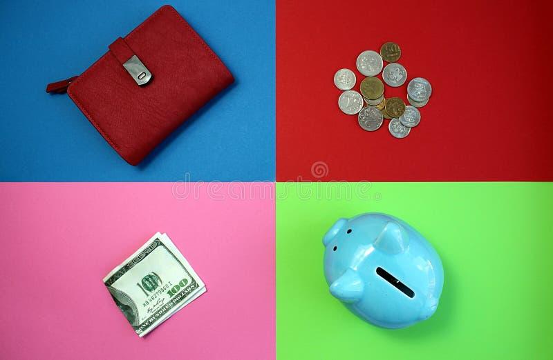 Geldbeutel, Geld, Sparschwein gelegen auf einem mehrfarbigen Hintergrund lizenzfreie stockfotografie