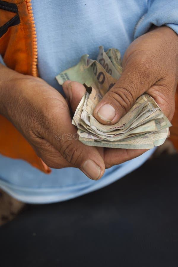Geldhanden royalty-vrije stock afbeeldingen