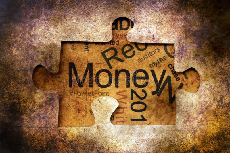 Geldpuzzlespiel-Schmutzkonzept stockbild
