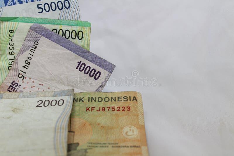 Geldumtauschfinanzgeschäftswirtschaft der indonesischen Rupie lizenzfreie stockfotos